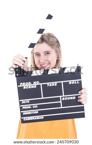 Cute girl with funny expression holding clapperboard - stock photo
