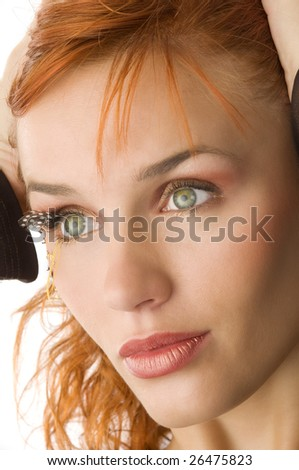 cute girl with great green eyes looking on one side