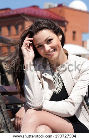 Cute girl with hair fluttering in the wind - stock photo
