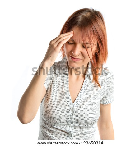 Cute girl with headache over isolated white background