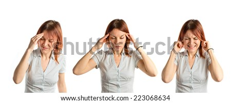 Cute girl with headache over isolated white background - stock photo