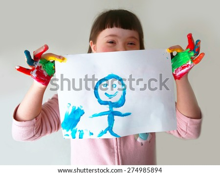 Cute girl with her painting - stock photo