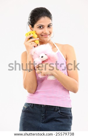 Cute girl with pink and yellow teddy bears