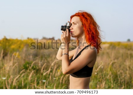 stock-photo-cute-girl-with-red-hair-maki