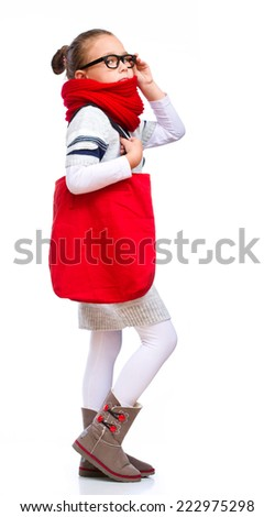 Cute girl with shopping bags, isolated over white - stock photo