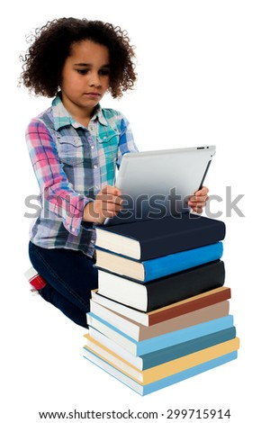 Cute girl with stack of books and tablet pc - stock photo
