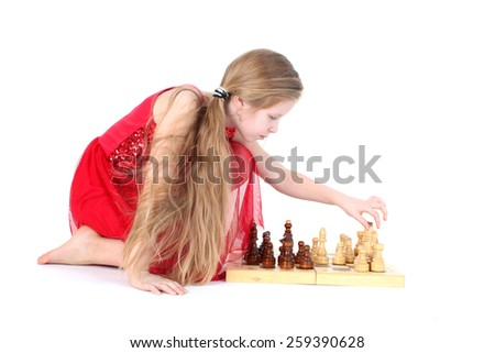 Cute girl 9 years old  play in chess on white - stock photo