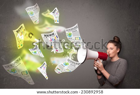 Cute girl yelling into loudspeaker and newspapers fly out - stock photo