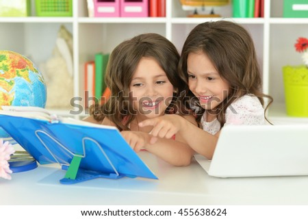 Cute girls  on lesson  - stock photo