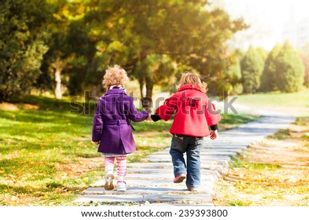 Cute girls walk in the rays of the autumn sun Outdoors shot - stock photo