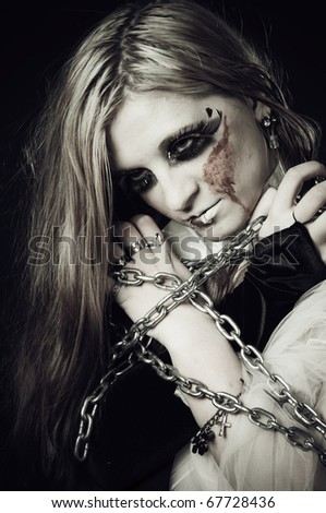 Cute gothic girl in chains