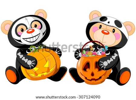 Cute Halloween Teddy Bears with costumes and treat - stock photo