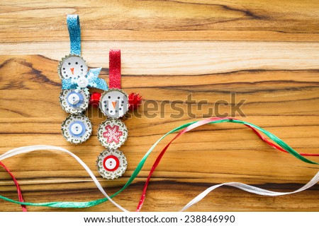 cute hand made recycled christmas ornaments on a wooden table - stock photo