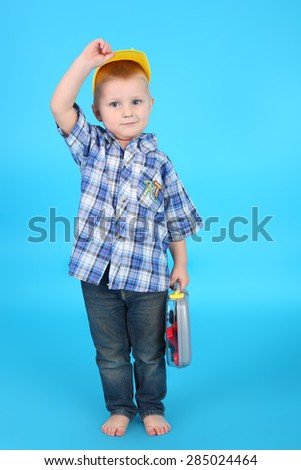 cute handsome little child playing with the instruments - stock photo