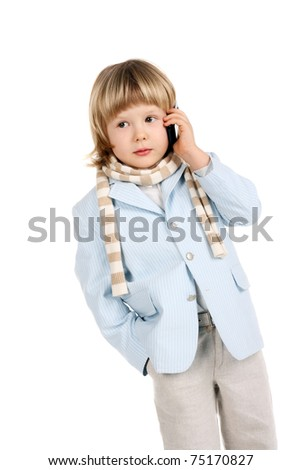 cute handsome little child speaking a mobile phone - stock photo