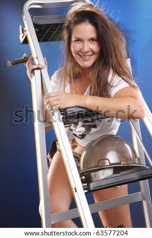 Cute handyman with cigar carrying a ladder - stock photo