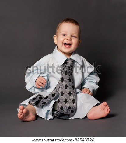 cute happy baby boss wearing over sized suit - stock photo