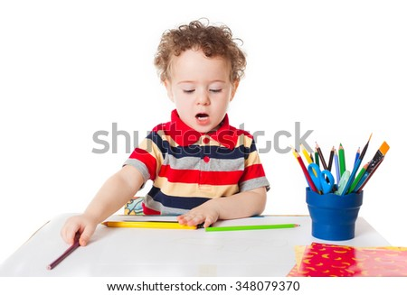 Cute happy baby boy kid child playing and drawing writing and talking, isolated on white background studio portrait