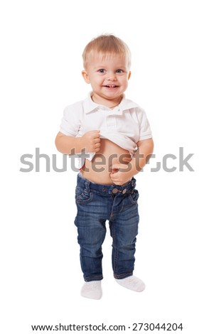 Cute happy baby boy kid touching his stomach, isolated on white - stock photo