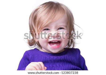 Cute happy baby is laughing fearless and freely with her new teeth, looking in to camera. Isolated on white. - stock photo