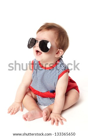 cute happy baby with sunglasses isolated on white background - stock photo