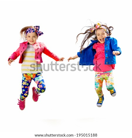 Cute happy children jumping. Isolated white background. Happiness, friendship, fashionable concept. - stock photo