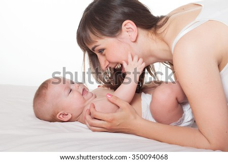 Cute happy family mother mum and baby boy girl on white background - stock photo