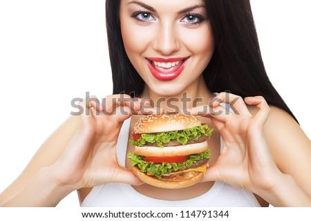cute happy girl holding hamburger on white background - stock photo