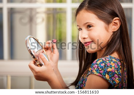 Child looking at a mirror stock photos images pictures for Mirror 7th girl