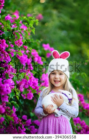 Cute happy girl with easter bunny  - stock photo
