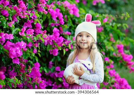 Cute happy girl with easter bunny