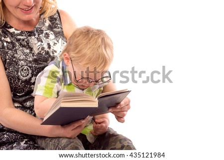 Cute happy kid potter style, reading a book - stock photo