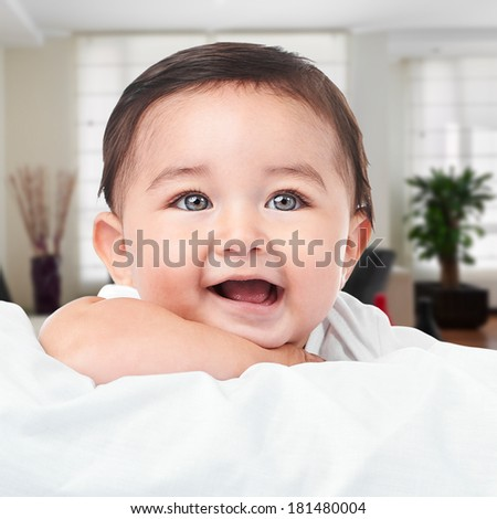 Cute happy little baby boy at home - stock photo