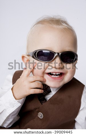 Cute happy little boy in sunglasses.