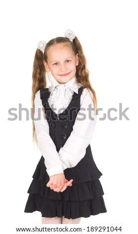 Cute happy little girl in school uniform isolated on white background - stock photo