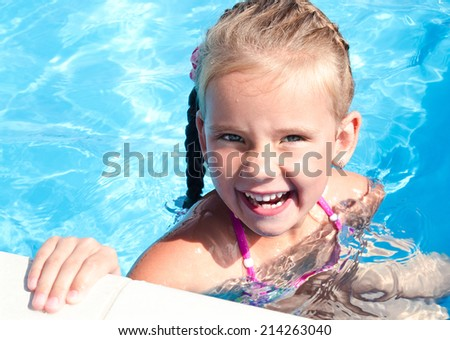 Cute happy little girl in swimming pool  - stock photo