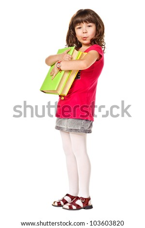 Cute Happy little schoolgirl with a stack of heavy books. Isolated over white - stock photo