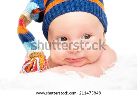 cute happy newborn baby in knitted hat cap - stock photo
