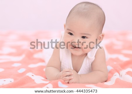 cute happy smiling asian baby boy