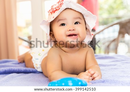 Cute happy smiling Asian baby with teeth from birth, 5 months after birth. - stock photo