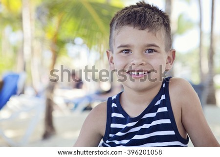 Cute happy smiling boy on beach vacation