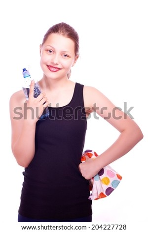Cute happy teen girl staying with towel and bottle of water and smiling