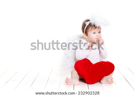Cute happy valentine angel with red soft heart, over white, portrait of a Cute adorable little valentine angel with red soft heart isolated on white background - stock photo