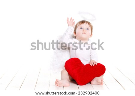 Cute happy valentine angel with red soft heart, over white, portrait of a Cute adorable little valentine angel with red soft heart isolated on white background