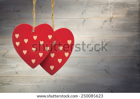 Cute heart decorations against bleached wooden planks background