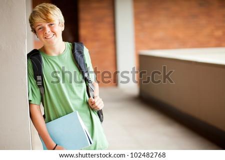 cute high school boy portrait in school - stock photo