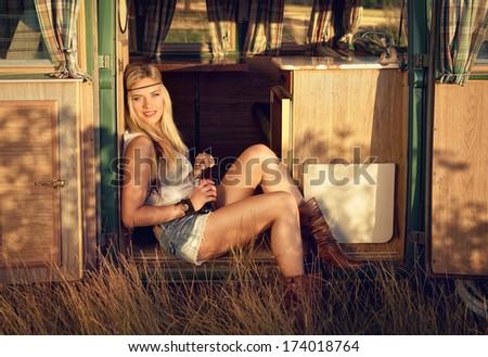 cute hippie girl on an old minibus - stock photo