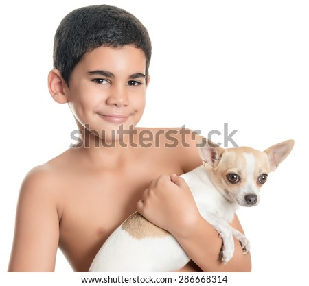 Cute hispanic boy carrying a small chihuahua dog isolated on white - stock photo