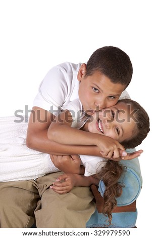 Cute Hispanic Brother and Sister on an isolated background - stock photo