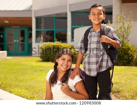 Cute Hispanic Brother and Sister Wearing Backpacks Ready for School. - stock photo
